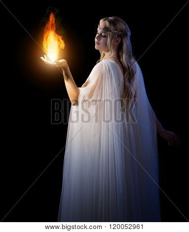 Young elven girl holding fire in palms isolated