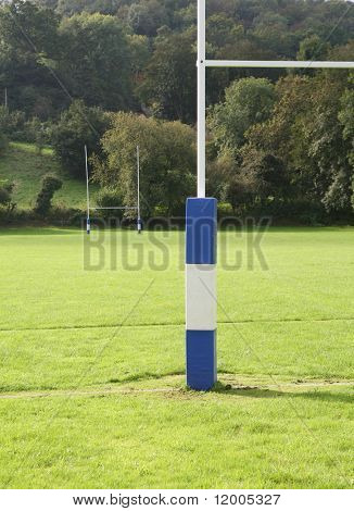 Rugby field with padded goal posts