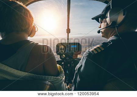 Man Flying A Helicopter With His Copilot