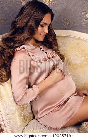 Beautiful Pregnant Woman With Luxurious Dark Hair