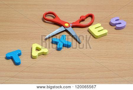 Scissors And The Plastic Alphabet Taxes.