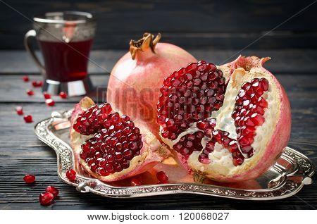 Pomegranate Juice And Pomegranate On A Dark Background