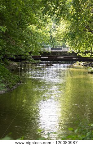 Old Concrete Bridge Over A Small River In Forest
