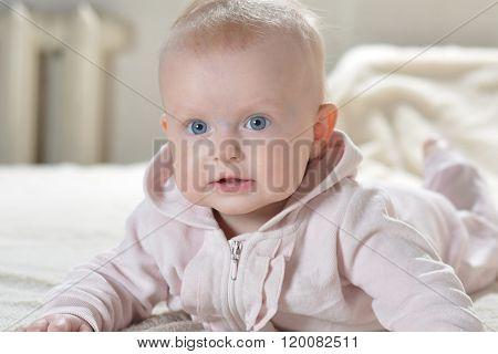 Baby Girl Wearing Pink Bathrobe
