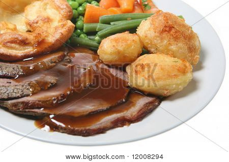 Roast beef with Yorkshire pudding, vegetables and gravy