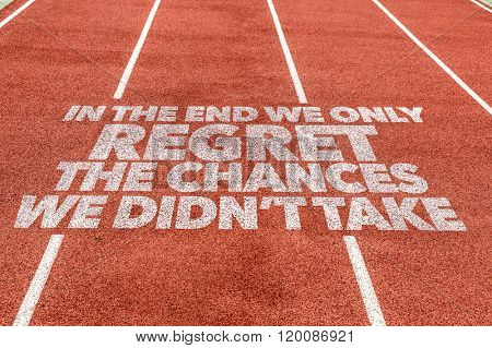 In The End We Only Regret The Chances We Didn't Take written on running track