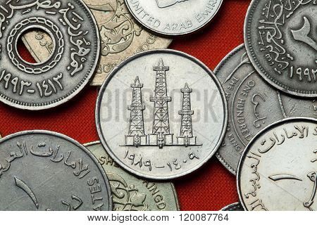 Coins of the United Arab Emirates. Oil derricks depicted in the UAE 50 fils coin.