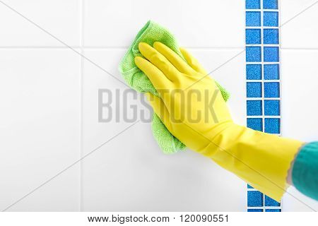 Hand wash a tile.