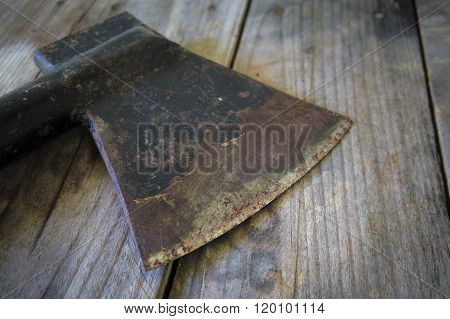 Old Ax On A Wooden Table