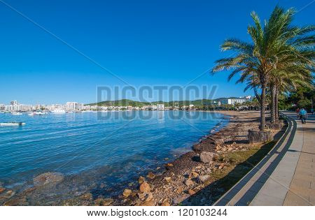 Mid morning sun on Ibiza waterfront.  Warm sunny day along the beach in St Antoni de Portmany.
