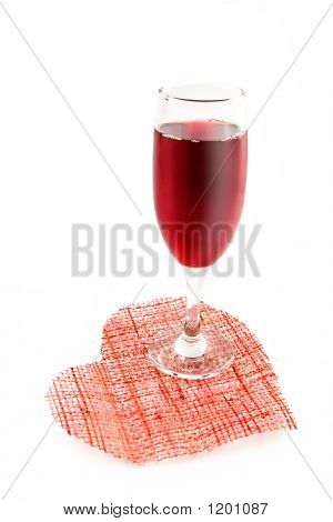 Glass Of Red Wine On A Background Of Heart