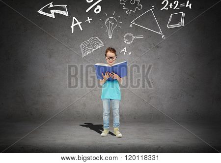 childhood, school, education, math and people concept - happy little girl in eyeglasses reading book over concrete room background with mathematical symbols