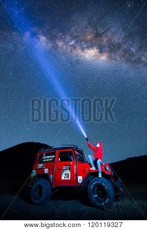 Bromo, Indonesia - June 22 : 4X4 Jeep For Rent With Traveller Among The Milky Way Over The Bromo Vol