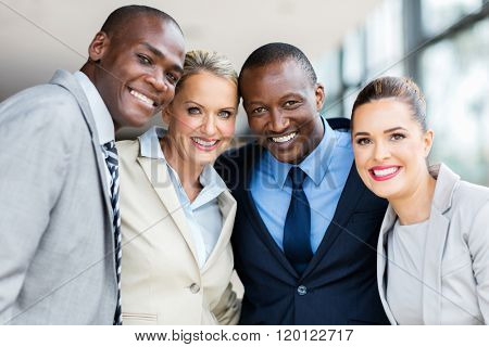 beautiful multiracial businesspeople looking at the camera