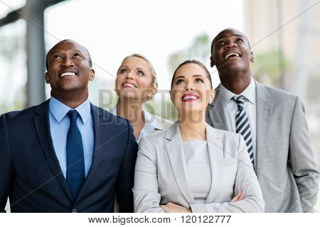 cheerful multicultural business group looking up