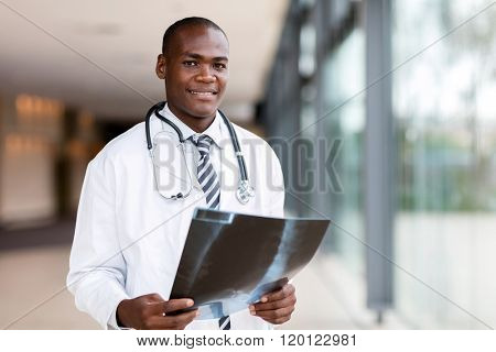 handsome african american male doctor holding x ray
