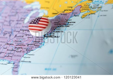 Pin With Plastic Flag Inserted In Map Of Usa