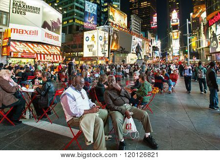 New York U.S.A. - October 9 2010: Manhattan, night view of  people and neon sign in Times Square area.