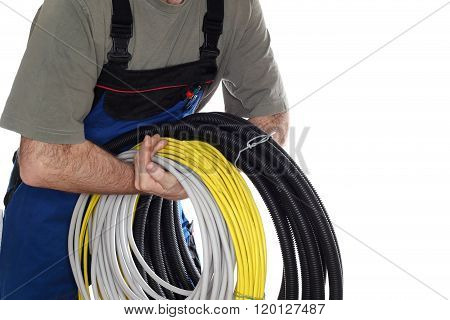 Worker With Wires In Arms