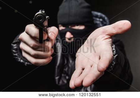 Robber with a gun in a mask
