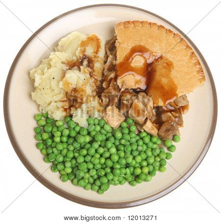 Chicken pie with mashed potato, peas and gravy.