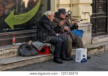Belgrade Serbia - February 27 2016: Two retirees playing guitar and singing on the street