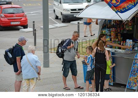 Tourists Are Near Street Kiosk In Barcelona, Catalonia, Spain.