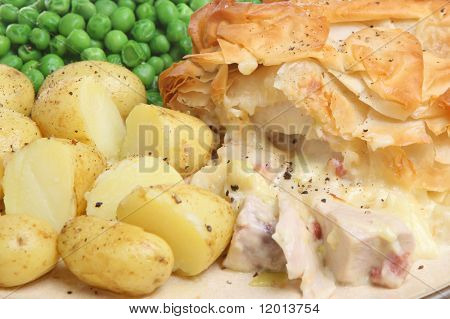 Chicken and bacon pie with new potatoes