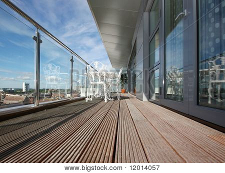 Penthouse apartment balcony with wooden decking