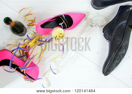Ladies Pink High Heela And Black Mens Shoes Lying Between Champagne And Streamers, Concept For A Wil