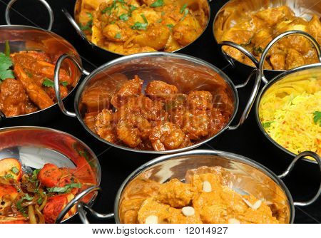 Selection of Indian curries and rice.