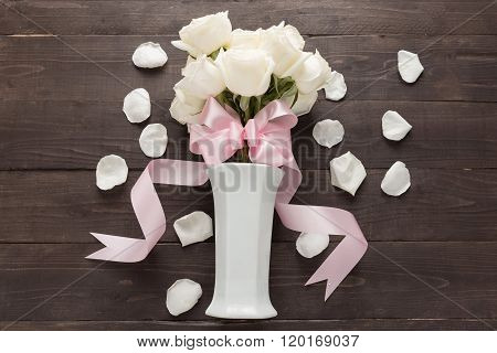 White Roses Flower With Ribbon Are In The Vase