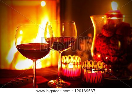 Red wine by the fireplace