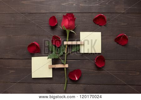 Red Rose Flower Is On The Wooden Background With Sticky Note