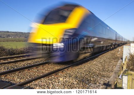 Close up of speeding train with extended exposure for motion blur
