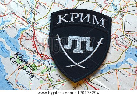 Kiev,Ukraine.FEB 20 Chevron of Islamic extremist formation Crimea.Background map of Kherson Caliphate on February 20,2016 in Kiev, Ukraine