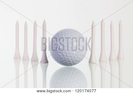 Golf Ball And White  Tees On The Glass Table