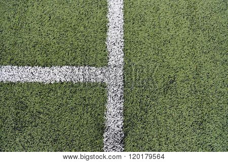 Detail Of Crossed White Lines On Football Playground. Closeup Of Lines In A Soccer Field. Plastic Gr