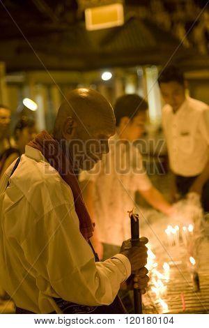 YANGON MYANMAR - FEB 19 : Unidentified Myanmar man in Shwedagon Pagoda on February 19 2011 in Yangon Myanmar. Shwedagon Pagoda is the most sacred Buddhist pagoda for the Burmese.