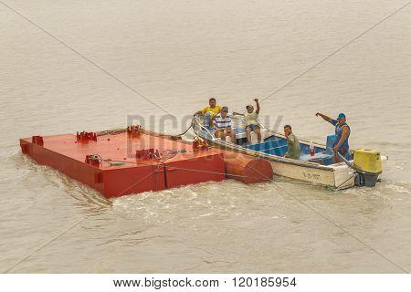 Wokers On A Boat Waving At The Camera