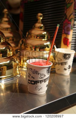 Frozen Strawberry Smoothie Slush In A Paper Cup With The Inscription Coffee