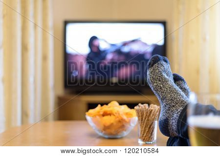 Man Watching Tv (man With Gun) With Feet On Table