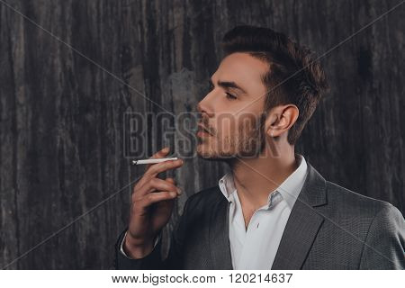 Sexy Brutal Man In Gray Suit Smoking A Cigarette