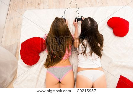 Top View Photo Of Two Sexy Girls In Panties Playing Video Game