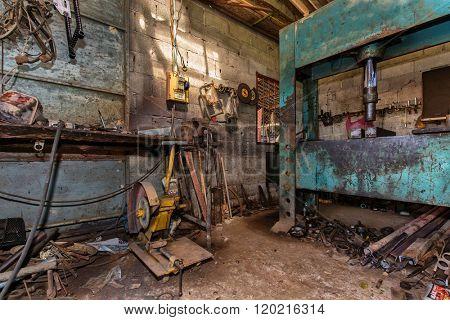 View inside a messy mechanical turner workshop poster