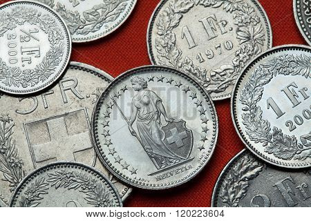 Coins of Switzerland. Standing Helvetia depicted in the Swiss one franc coin.