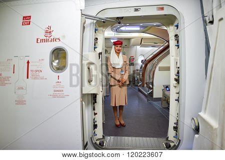 HONG KONG - SEPTEMBER 09, 2015: Emirates Airbus A380 flight attendant. Emirates handles major part of passenger traffic and aircraft movements at the airport.