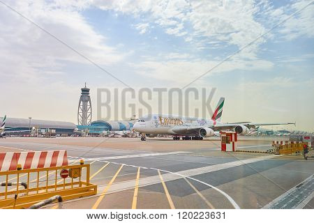 DUBAI, UAE - JUNE 23, 2015: Airbus A380 in Dubai airport. Dubai International Airport is a major airline hub in the Middle East, and is the main airport of Dubai.