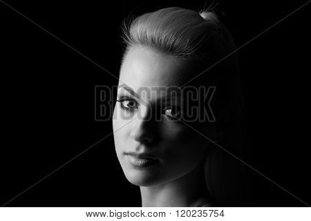 Woman Portrait Silhuette In Darkness With Soft Light On Face.