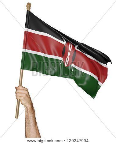Hand proudly waving the national flag of Kenya